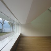 complex steel structure concealed above window enables continuous window span