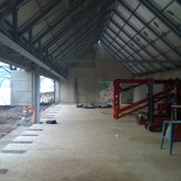 the training room with concrete slab, steel structure + roof