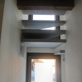 The stairs leading to the attic floor, as seen from the ground floor ©Giulia Caramello