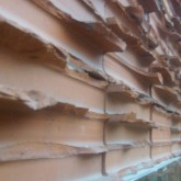 broken red brick covering detail © Amit Even 2012