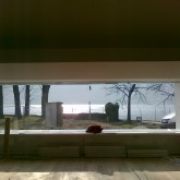 the view from the function space to the building site and lake
