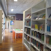 ground floor-the library furnitures use as a division of the playing area for children(4-7age) and the reading area for children (7-12age)© Pantelina Polychronidou - Niki Georgiou 2012