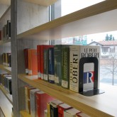 first floor-windows with a structure of shelves for books in front© Pantelina Polychronidou - Niki Georgiou 2012