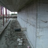 reinforced concrete wall of  the foundation with tubes for ventilation (external view) © Andrea Oliva 2007