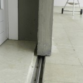 the sliding EPS100 4 cm panel used as shielding and its track on the floor © Erika Mazza 2012