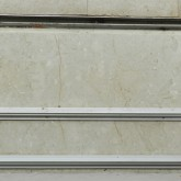the sliding window track (below) and the shielding panels track (above) on the marble floor © Erika Mazza 2012