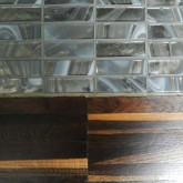 bathroom on the first floor : detail of the floor in smoked oak which becames in platinum and Murano glass next to the shower © Erika Mazza 2012